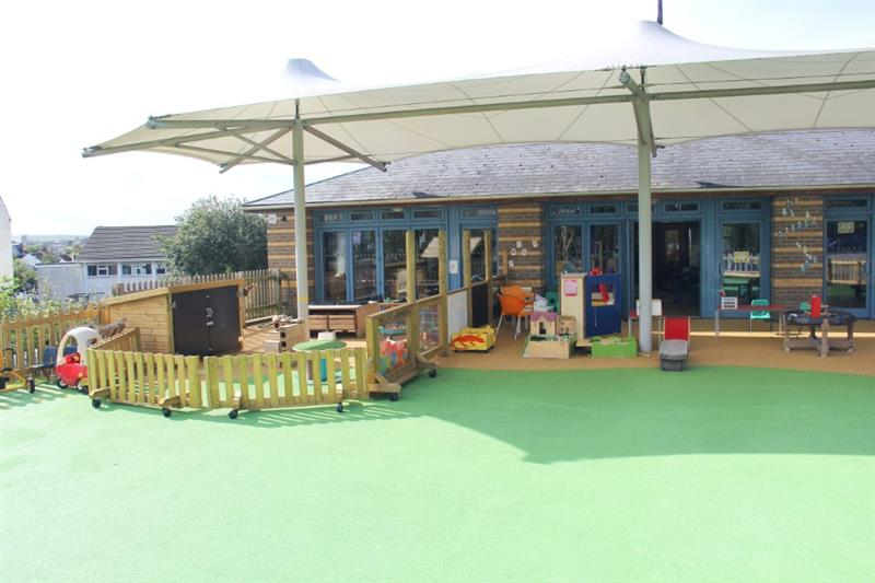 Playground resources placed on top of green and orange wet pour surfacing