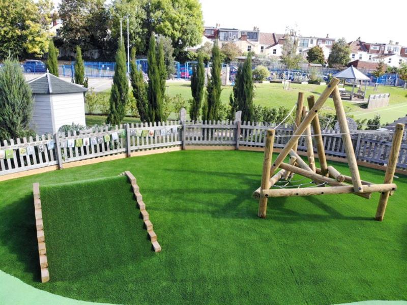 A climbing frame installed onto artificial grass surfacing