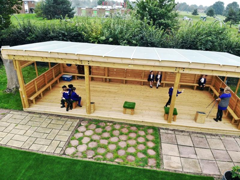Children playing in an outdoor classroom