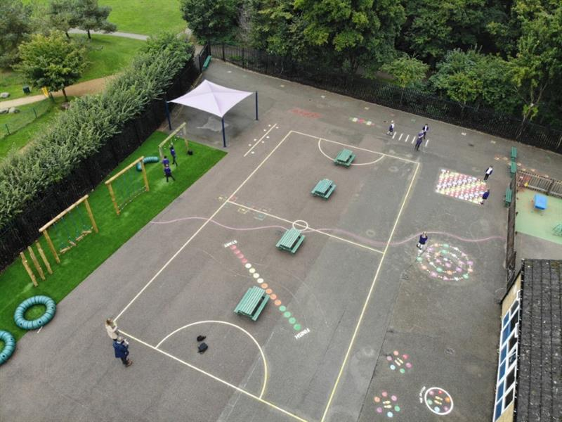 an ariel view of Bedgrove Infant School's new thermoplastic markings on the playground's tarmac surface