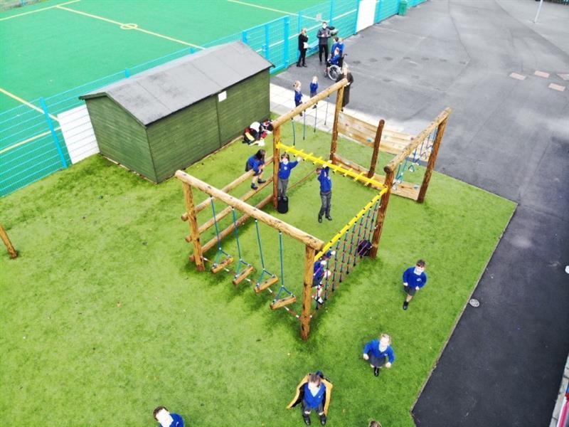 Children climbing on a playground climbing frame