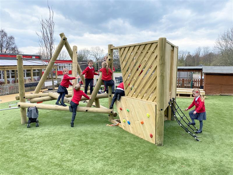 7 reception class children climbing on pentagon plays harterfell climber with platform and climbing net