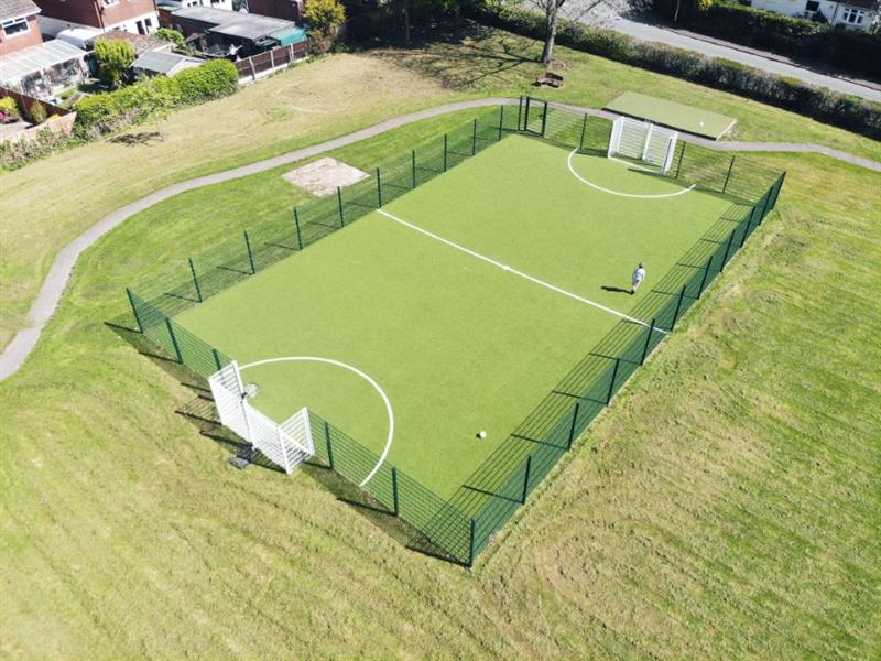 A muga pitch installed onto a primary school field
