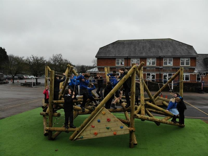 Children playing on pentagon plays biggest climbing frame ever, the crinkle crags climber, that has been installed onto artificial grass surfacing