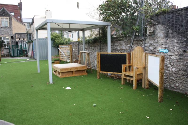 EYFS playground equipment installed onto artificial grass surfacing