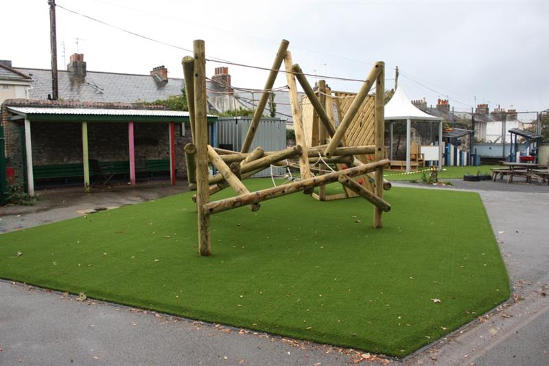 Artificial Grass installed underneath a log climbing frame