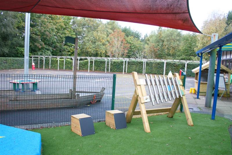 Moveable outdoor musical instruments placed onto playground surfacing