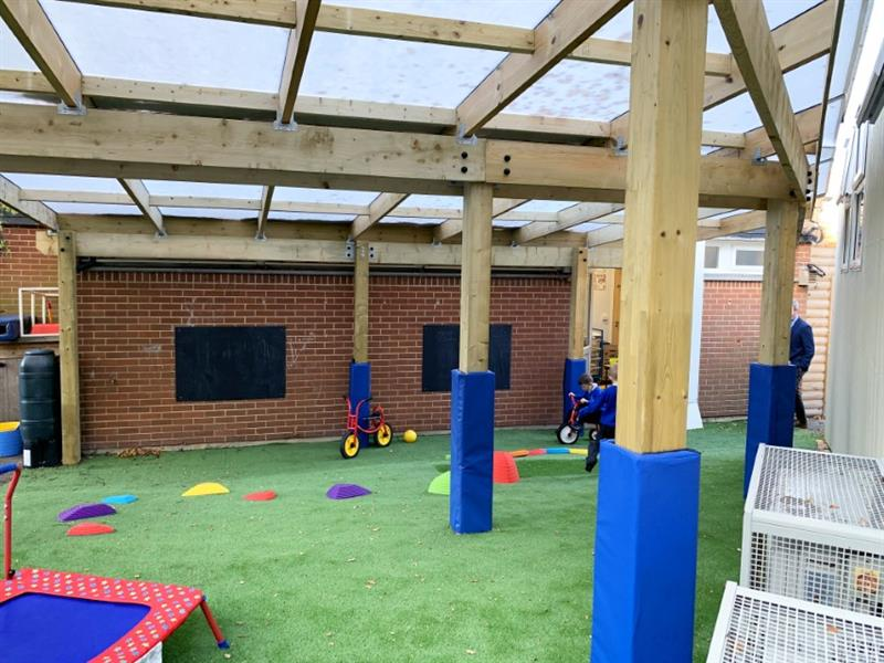 A timber canopy installed outside of the classroom doors