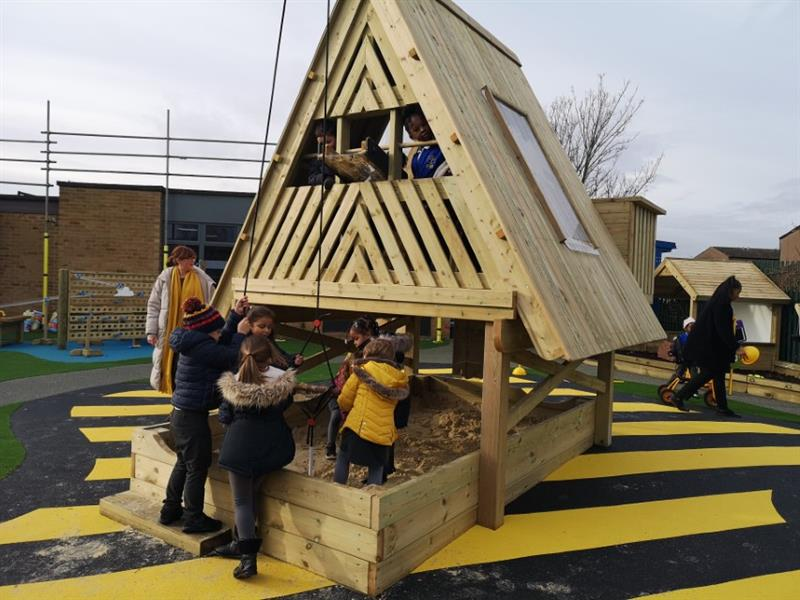 Children playing in an investigative playhouse