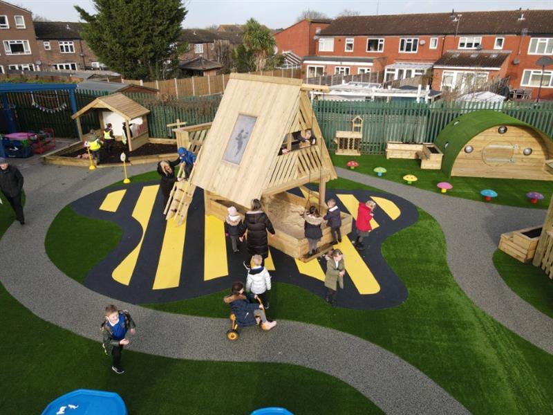 Children climbing up the ladder into an investigative playhouse