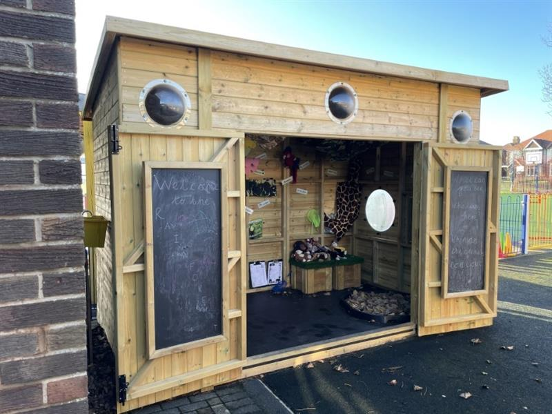 A play cabin with a jungle theme installed in the school playground