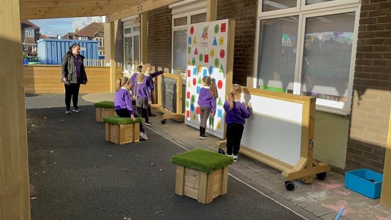 Children mark making on interactive activity panels