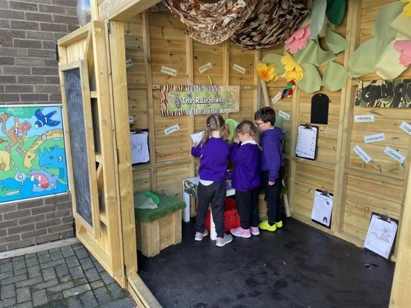 KS1 playing inside a play cabin