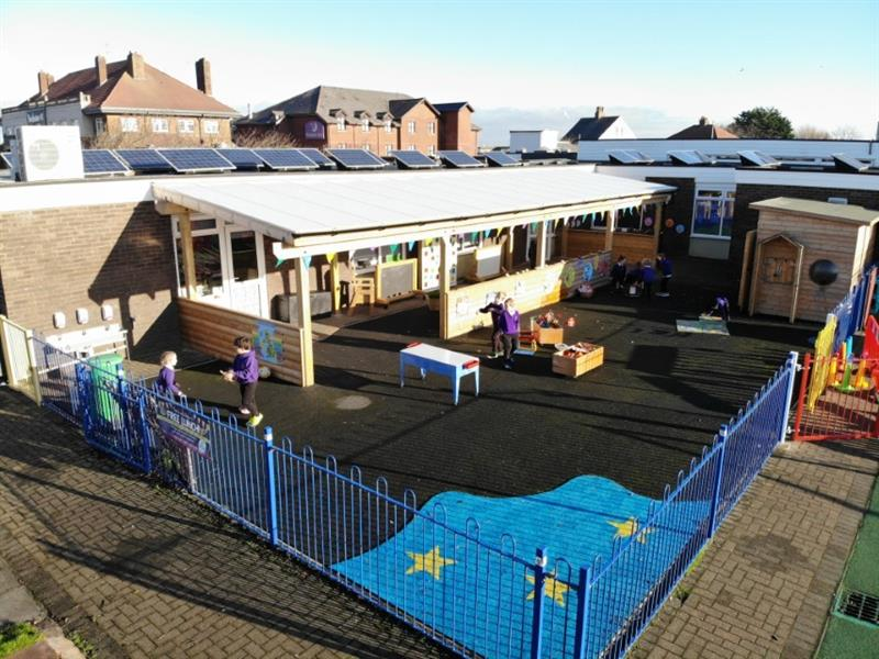 A KS1 outdoor learning environment with educational playground equipment