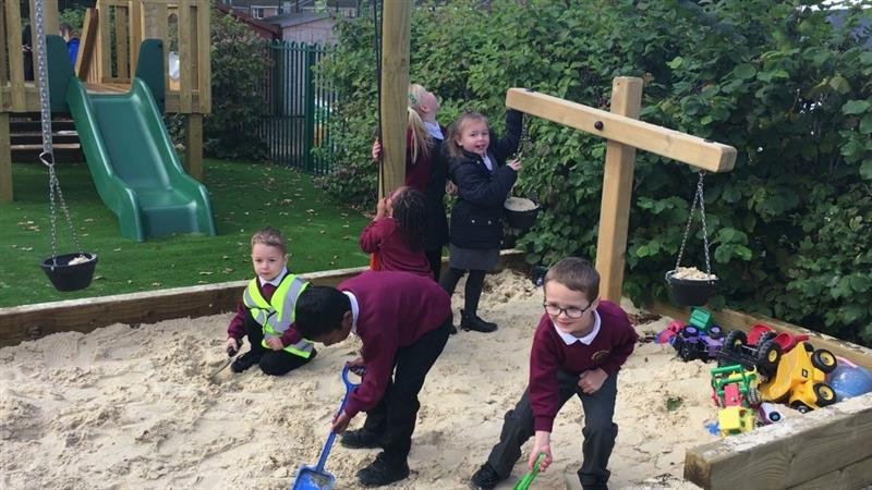 Children playing in a bespoke sand pit