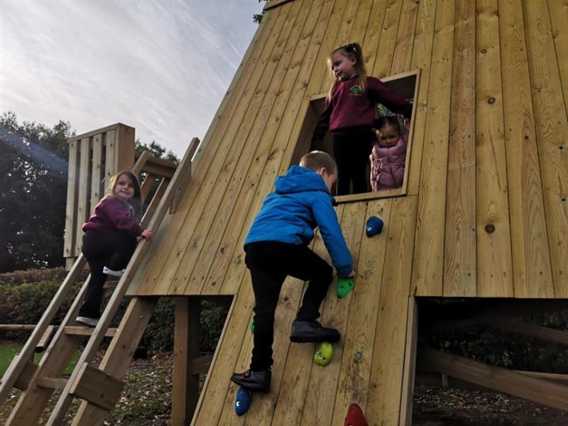 Children playing in a school playground den