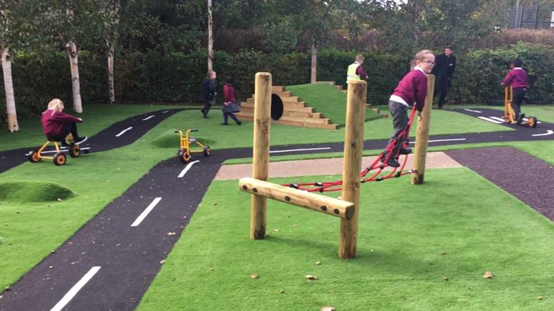 EYFS children playing on all weather playground surfacing