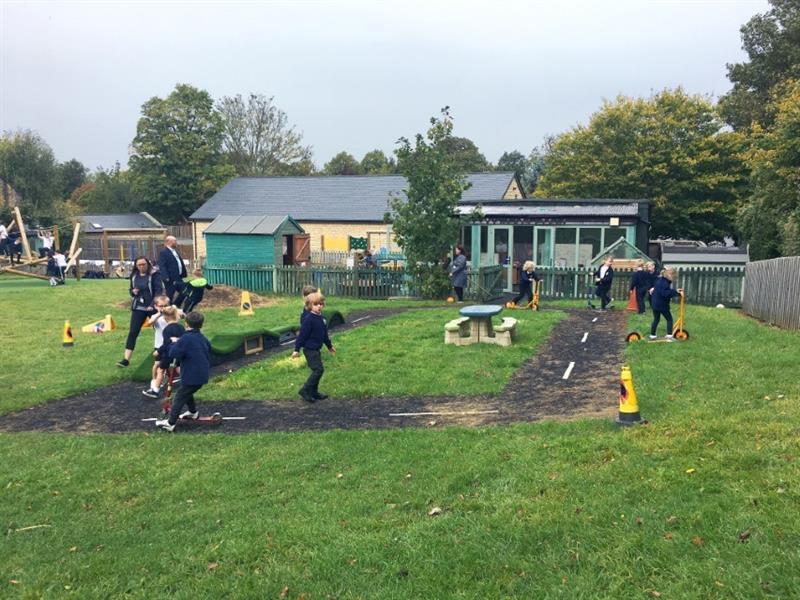 Children running around on playground surfacing