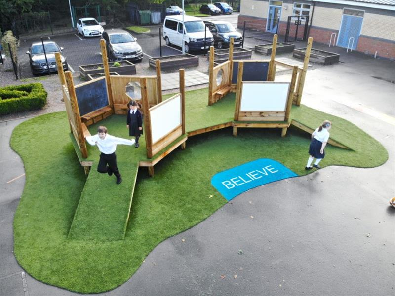 Children playing imaginative play games on themed playground equipment