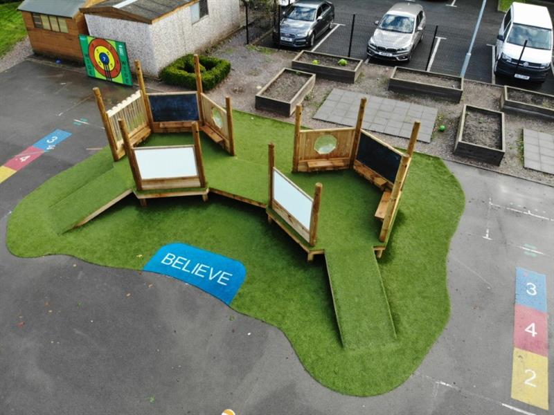 A pentagon play imagination station installed on a school playground