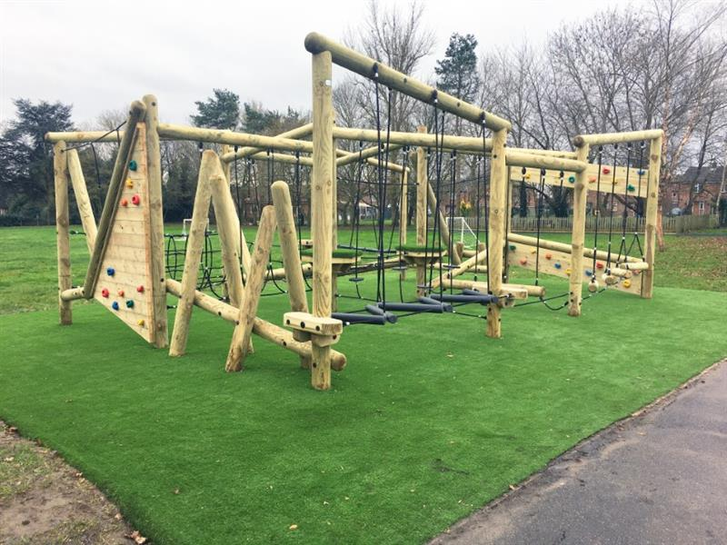 Pentagon Play's grizedale forest circuit installed onto the school playground with artificial grass underneath