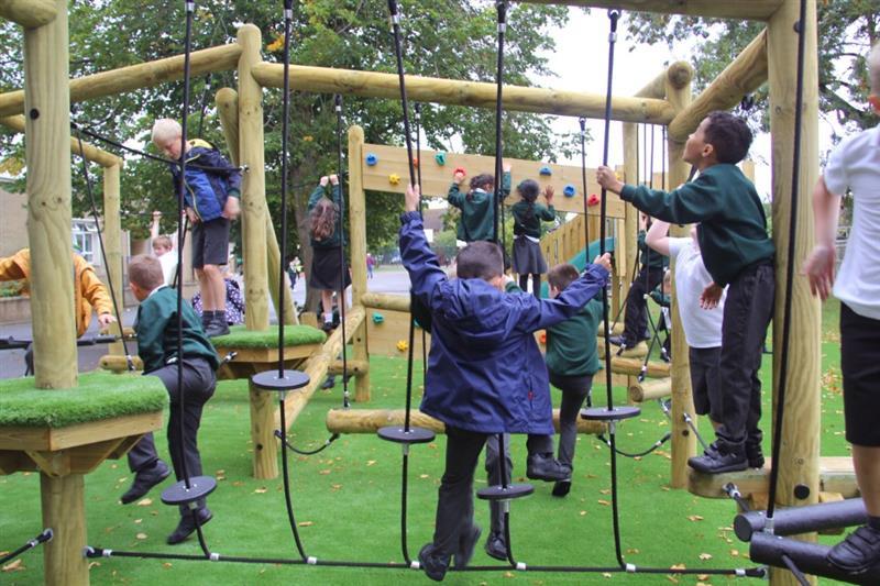 Children climbing on a Pentagon Play Climbing Frame