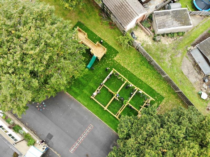 Artificial Grass surfacing under school playground equipment