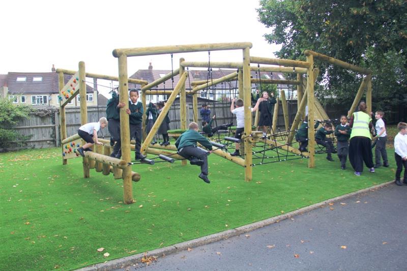 Children climbing on a school playground climbing frame