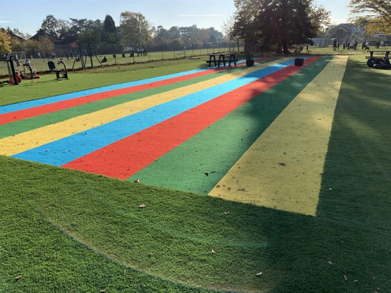 Artificial Grass and colourful saferturf surfacing installed onto a school field