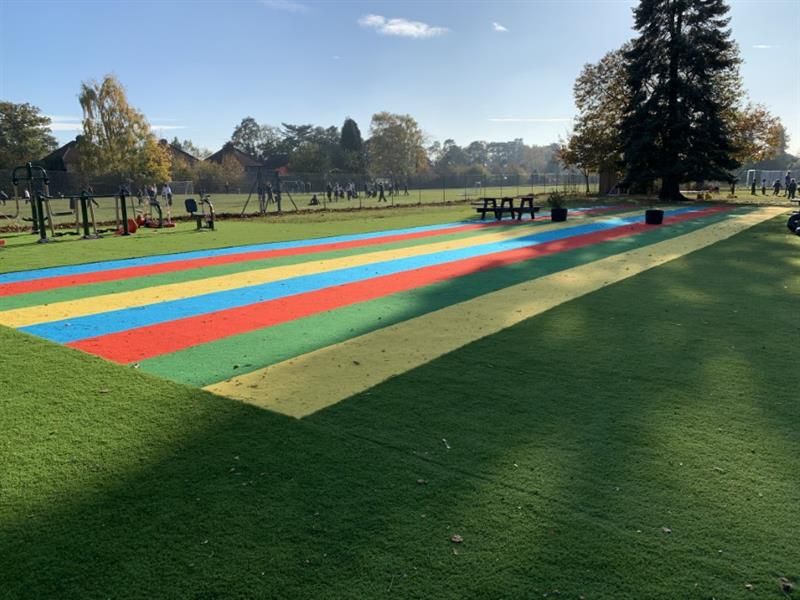 Playground surfacing installed onto the school field to create an all weather space
