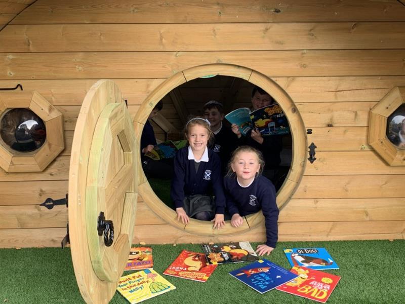 Children inside a Hobbit House playground den