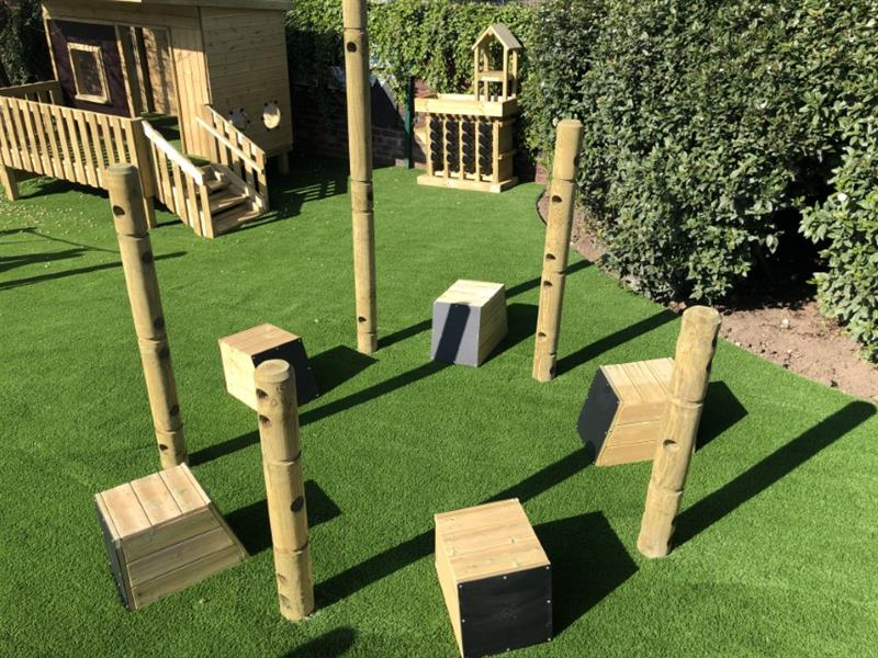 Drum Seats in-between Den Making Posts within the playground