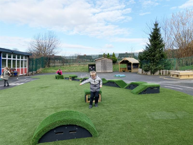 Children playing on artificial grass surfacing