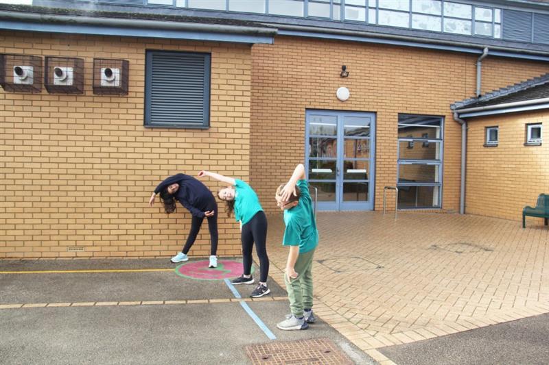 Children using thermoplastic playground markings