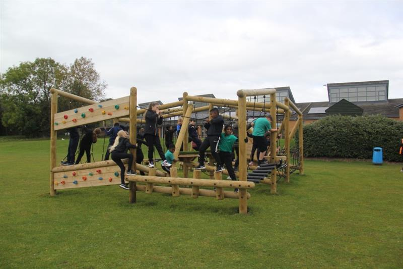 A climbing frame featuring 18 unique challenges installed onto natural grass