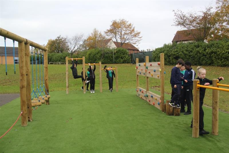 Trim trail equipment installed onto artificial grass