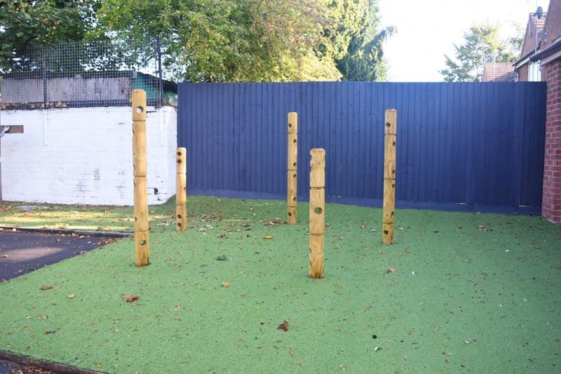 5 den making posts installed onto artificial grass surfacing