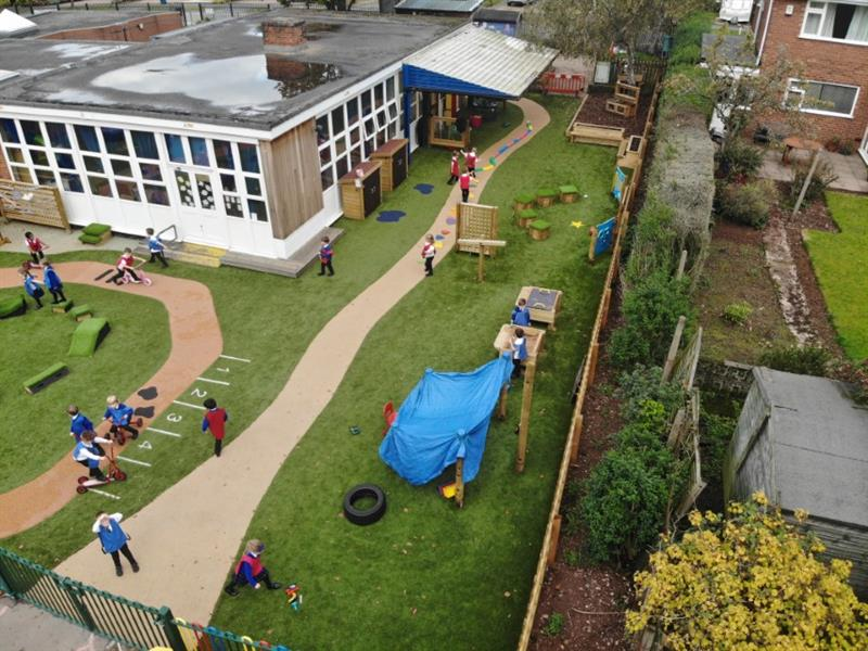 EYFS children playing in an all-weather school playground