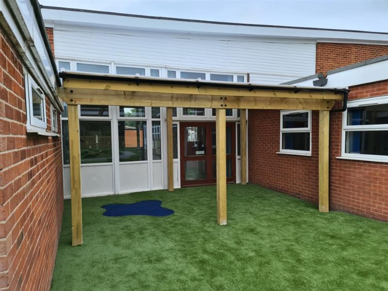 A timber canopy installed outside the eyfs classroom doors