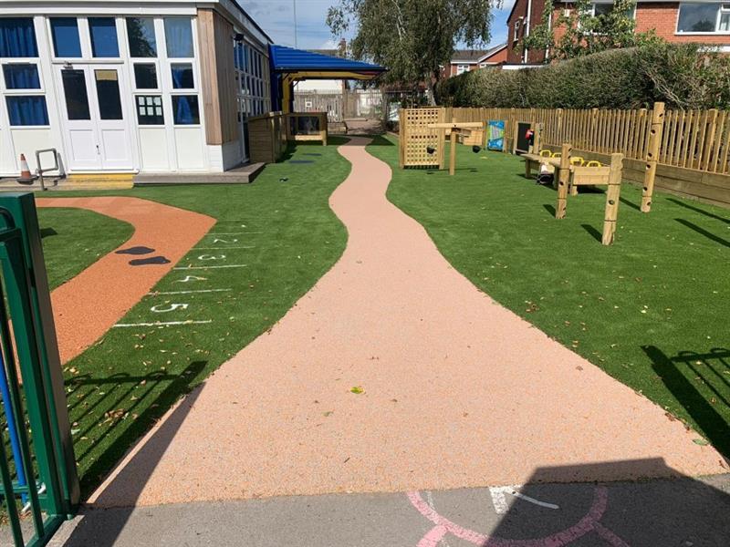 Wetpour pathway running through an eyfs playground