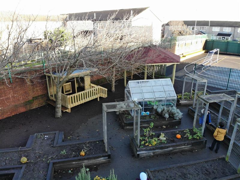 A look out cabin and 5m gazebo installed at the back of a school garden to create a forest reading area