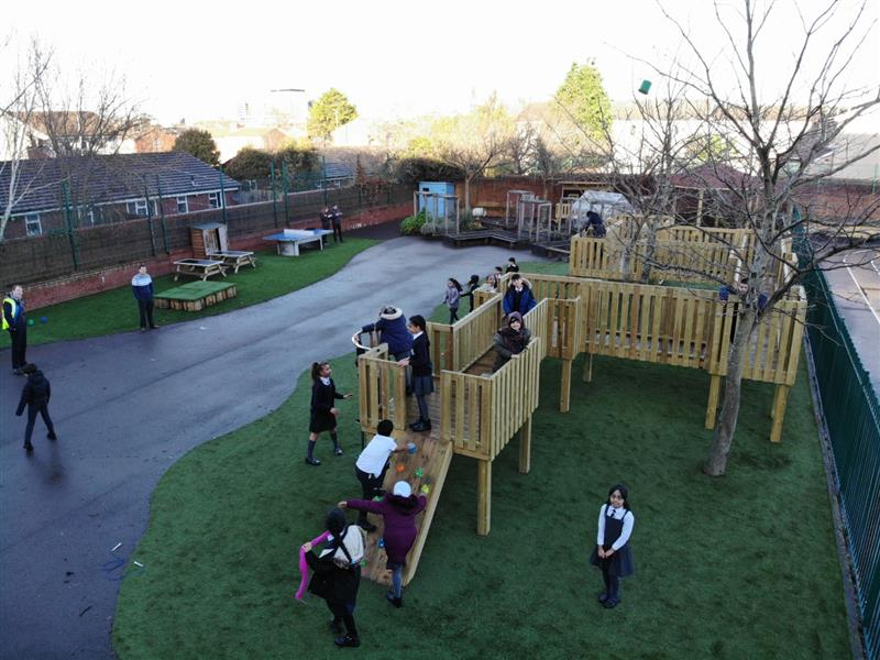 Children playing on a huge playground treehouse