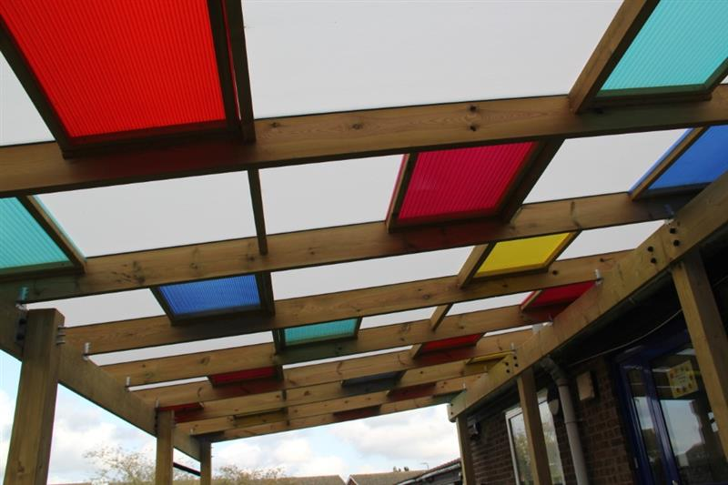 multi-coloured roof on a Pentagon Play timber canopy