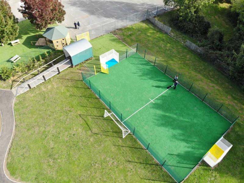 A muga pitch installed onto a school field