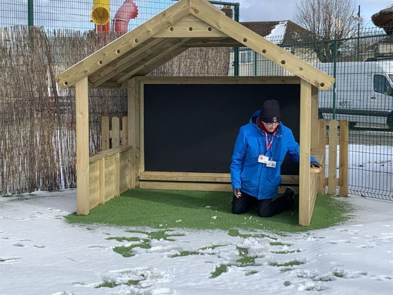 Sam Flatman inside a giant playhouse