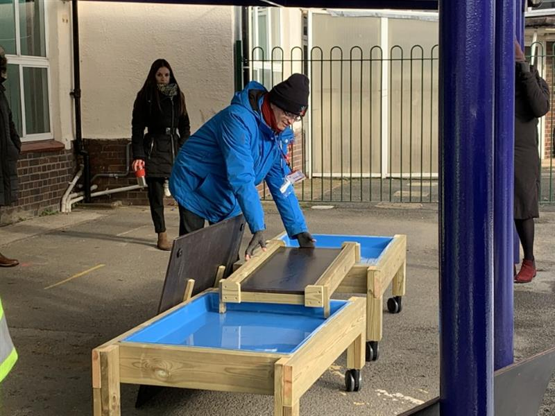 Sam Flatman showing teachers how to effectively use messy play tables on wheels