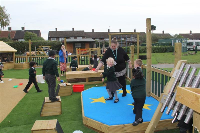Children playing with school playground equipment
