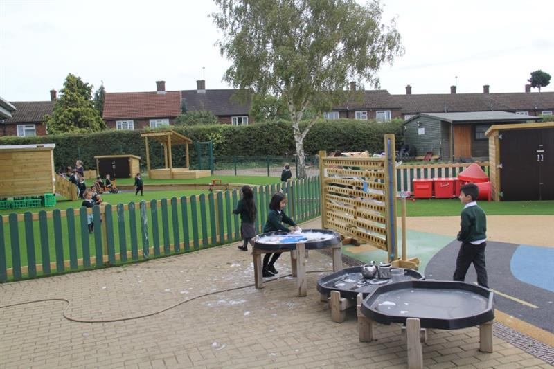 Children playing with EYFS School Playground Equipment