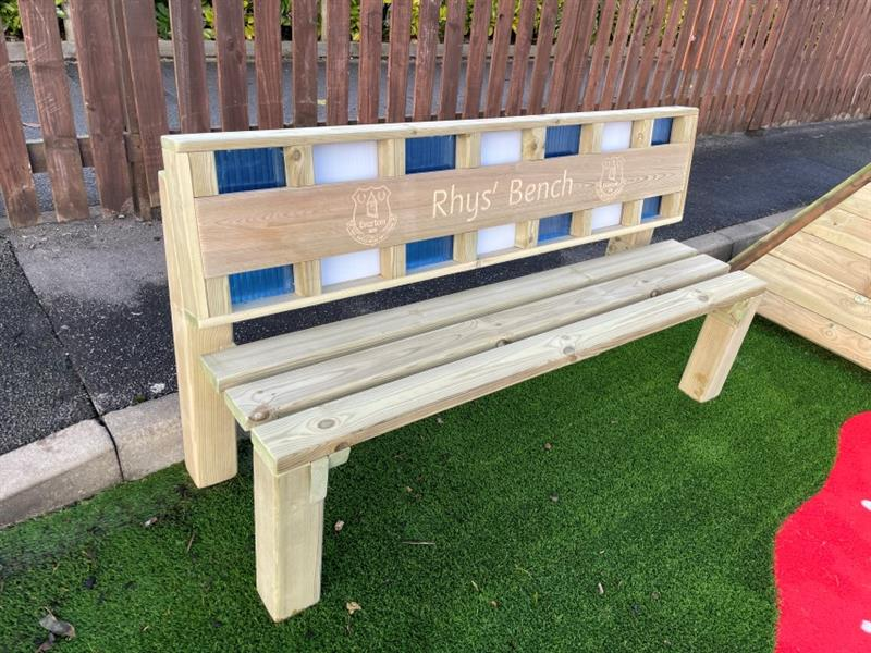 Bespoke memorial bench for former pupil Rhys Jones, using the colours blue and white for the back of the bench with the Everton Flags and Rhys Jones engraved onto the bench.