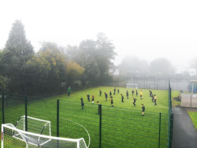 A pe lesson taking place on a multi use games area